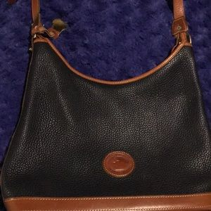 A barely used Dooney & Bourke purse.